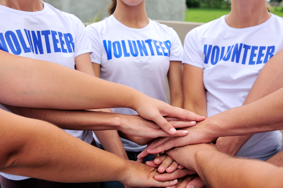 bigstock-volunteer-group-hands-together-15610862